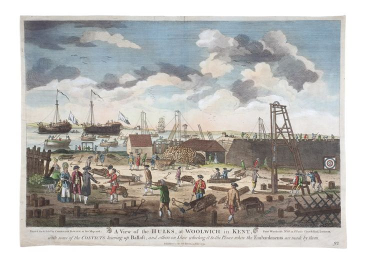 A View of the Hulks, at Woolwich in Kent, with some of the Convicts heaving up Ballast, and others on Show wheeling it to the Places where the Embankments are made by them. THAMES HULKS.